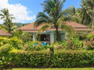 Nestling in lush tropical gardens with own private swimming pool