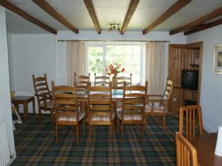 dining room with an 8 seater table & a six seater table