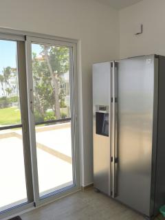 Large fridge/freezer with water and ice dispenser.
