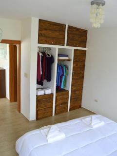 Bedroom with King size bed, brand new memory foam mattresses, Hotel Luxury pillows, Air con, wall fa