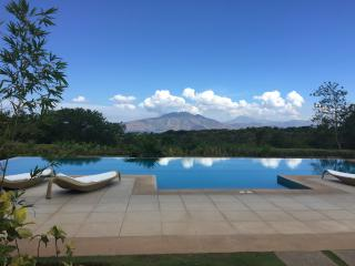 Condo pool with view across Subic Bay to The Zambales Mountains
