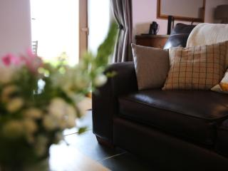 Hand made soft furnishings dotted around the cottage give a warm, cosy feel