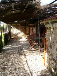 Bar b q area in the garden. A sheltered area with electric supply for music. Lit area.
