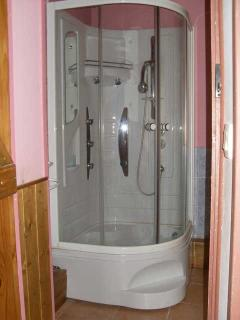 bathroom with turbo shower downstairs. Electric towel rail