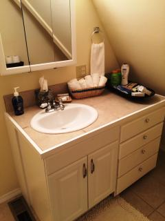 Large Bathroom Upstairs with tub and shower, vanity, toilet and full size shampoo, conditioner, soap