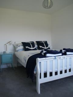 Rear facing double bedroom with sea views