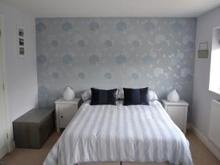Top floor master bedroom with ensuite shower, basin and sink