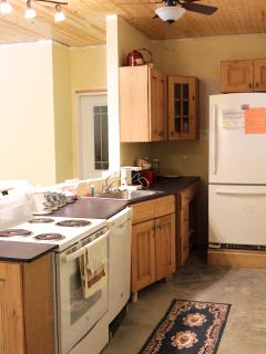 A full kitchen including full size refridgerator, dishwasher, stove, oven and microwave