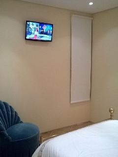 quarto de dormir com TV