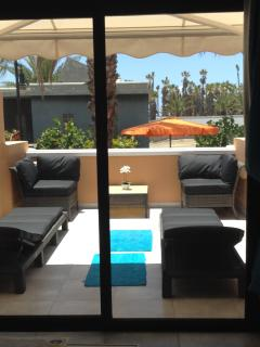 Sunny balcony with comfortable seating/ loungers and Sun Canopy