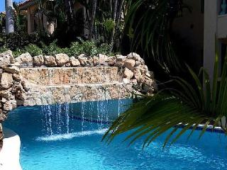 Swim under the waterfall in this 85' pool