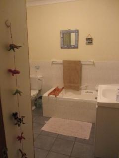 Bathroom with bath and shower and toilet.