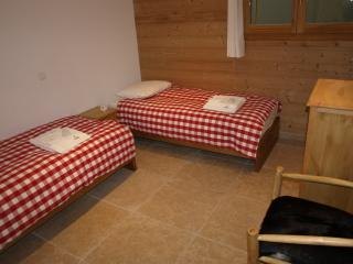Second bedroom with two single beds or one double bed