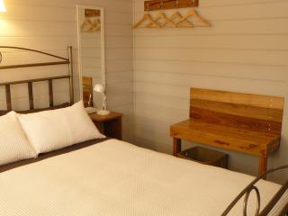 Queen bedroom with luggage bench and hanging space - all you need really!