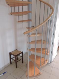 spiral staircase leading to third en suite bedroom and roof terrace