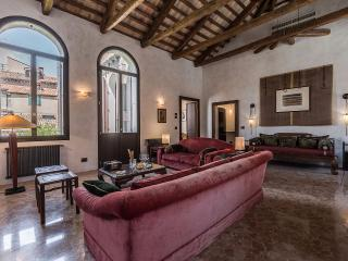 with tall arched windows overlooking peaceful gardens