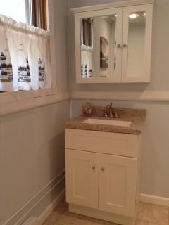 new, remodeled bathroom with shower stall-has built-in seat (no tub)
