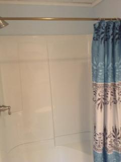 brand new bathroom with large shower w/ seat.