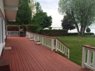 Fifty-foot long deck overlooks the bay and offers ample sitting space.  BBQ is provided.