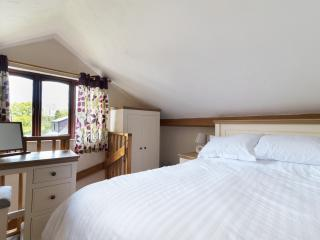 Galleried double bedroom with views over the courtyard garden