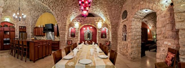 400-year-old stone dome graces the majestic dining room. Seating for 16.