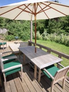 Teak table, chairs with cushions and parasol