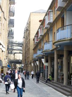 View of Shad Thames Street, with cross bridges in the distance
