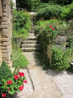Steps down to the sunny garden