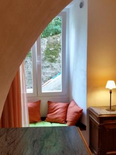 Window seat for relaxing moments in bedroom.
