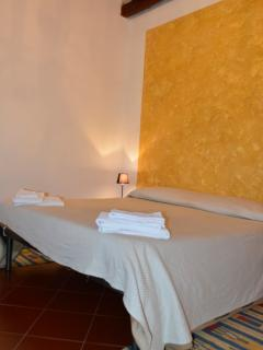 Bedroom with double bed suitable for 2/3 persons. One of the 3  bathrooms is just in front