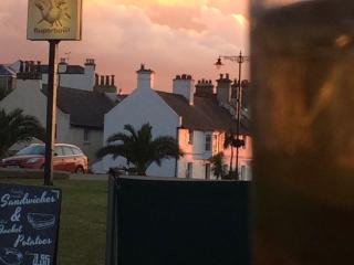 View of cottage from bowling alley, best place to enjoy a jug of pimms at the end of a hot day.