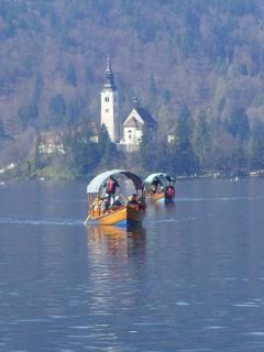 Boats on Lake Bled which take visitors to the Island