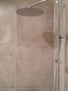 Recently refurbished luxury bathroom with walk in rain shower