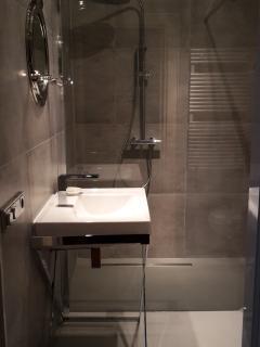 Recently refurbished luxury bathroom with walk in rain shower