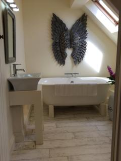 Beautiful light and airy bathroom - en-suite to bedroom 1.