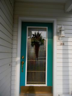 The front door welcomes you to 166 Rolling Green