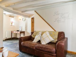 Lounge with deep set sofas and woodturner