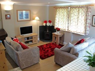Lounge with 32' TV, electric 'wood burning stove', two comfy sofas