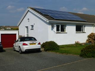 The bungalow is located 2 minutes walk from the beach on a cul-de-sac with double yellow lines