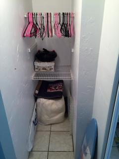 Good size closet in master, ironing board and iron.