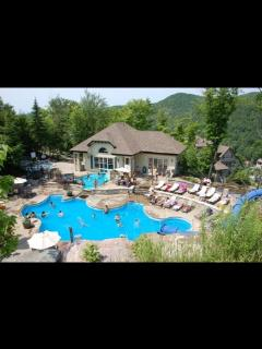 Summer at the pool and slide and hot tubs