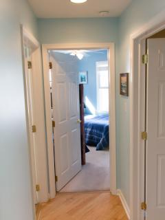 Hallway With Qeen Bedroom On Left And Bedrooms 1 & 2 With Bunkbeds Straight Ahead And On Right