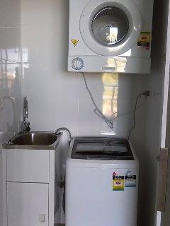 Washing machine and dryer available for use within the apartment