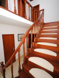 Stairs to the bedrooms on the upper floor