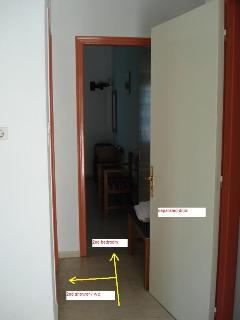 hall leading to 1 st bedroom & separated door