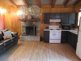 Full kitchen, fireplace, leather sleeper sofa and dining area...how convenient!