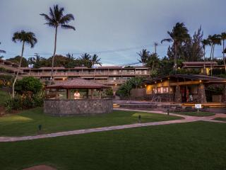 Twilight view of Kahana Sunset from beach - large grassy area, bbq and pools