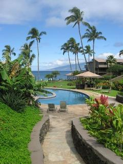 Daytime view towards ocean/Molokai of  heated pool/children's pool and bbq area