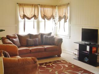Living room, couch, sofa, full air mattress, lcd tv, ceiling and standing fans