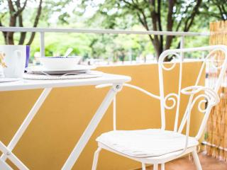Shaded by trees and overlooking the river, the balcony area is a relaxing spot for breakfast